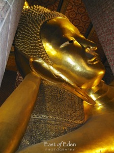 Wat Pho Temple: Buddha's eyes and feet are inlaid with mother-of-pearl