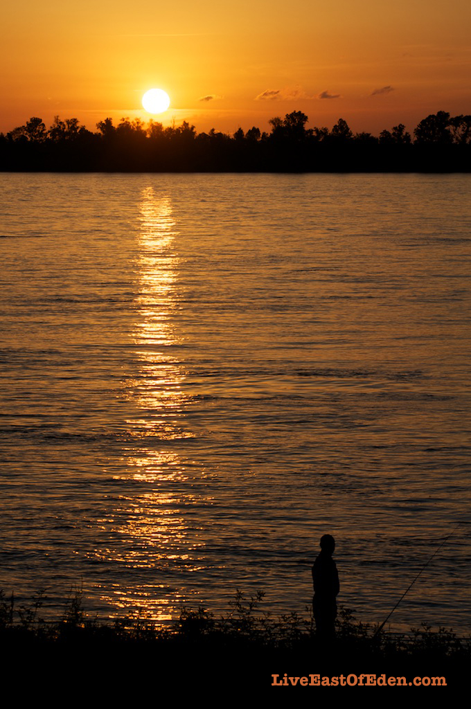 A man fishing along the Mississippi River. Vacherie, Louisiana